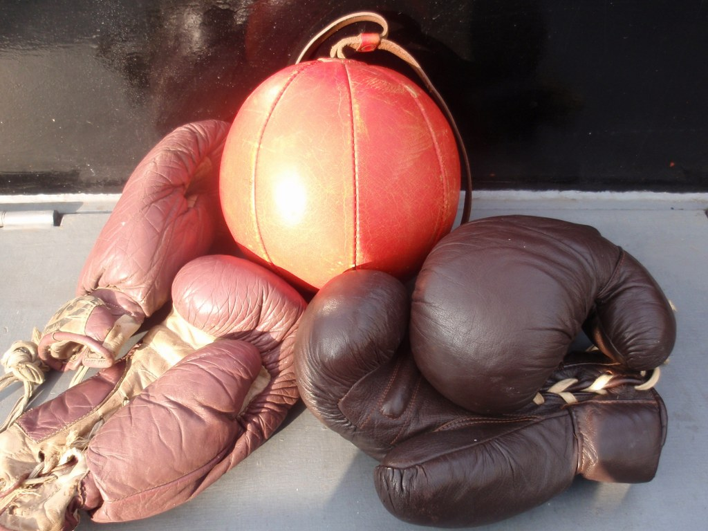 Vintage boxing ball with two pair boxing gloves