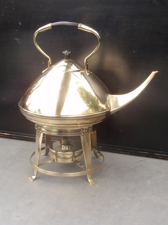 Large brass kettle on stove by Eisenloeffel