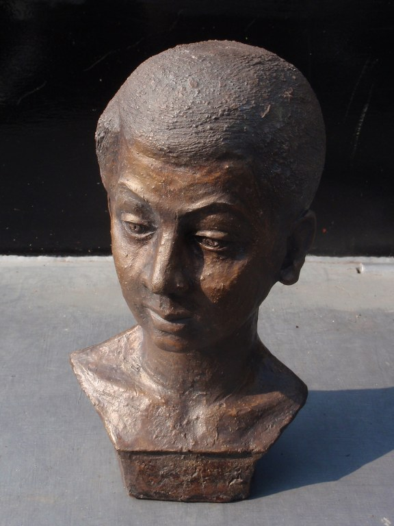 Portrait of woman in clay 1950