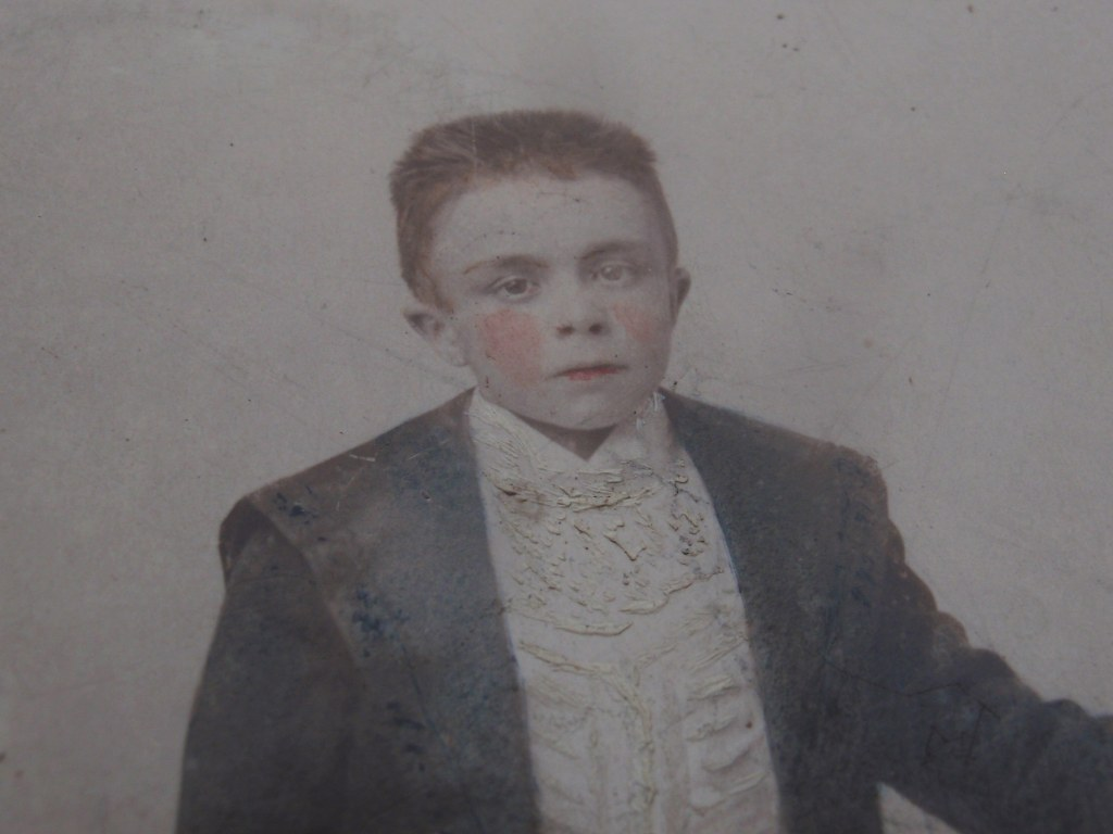 Early hand coloured photo of boy from Mechelen/Malines