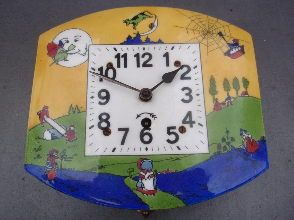Antique German Nursery enamel wall clock