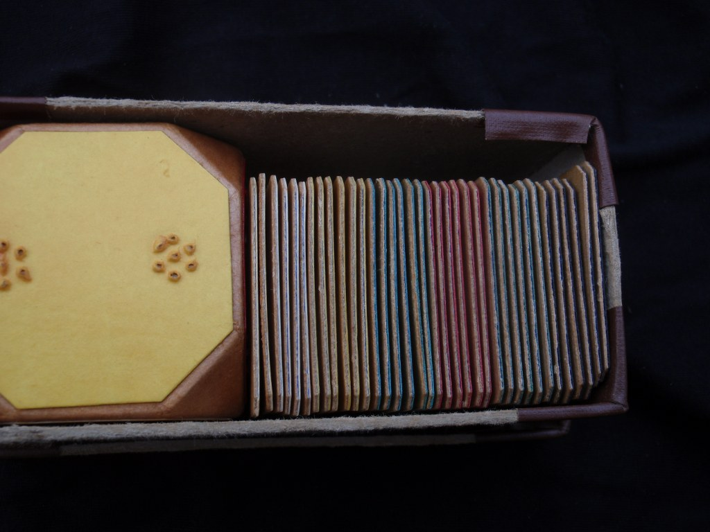 Wooden braille game with dice and cards