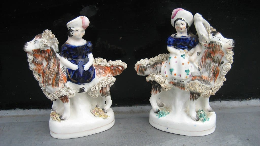 Pair of Staffordshire figurines of girls on he-goats-1