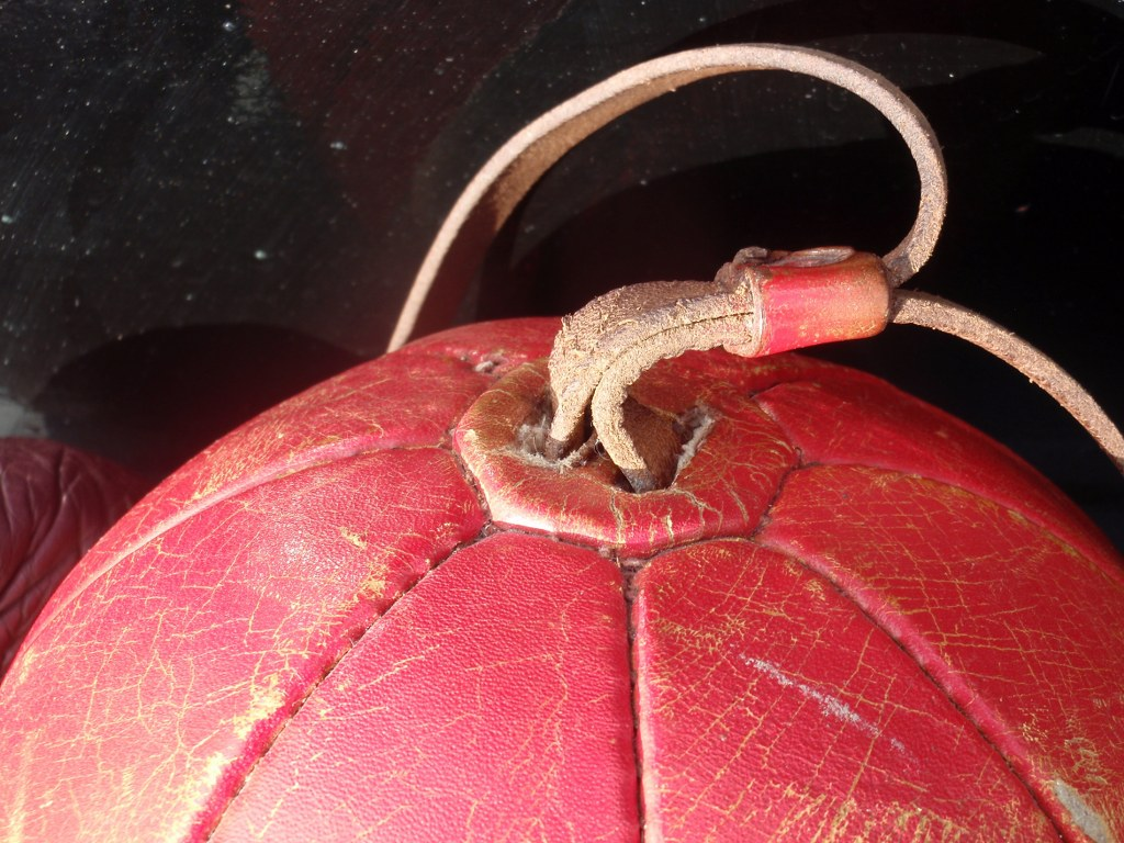 Vintage leather boxing ball with two pair boxing gloves