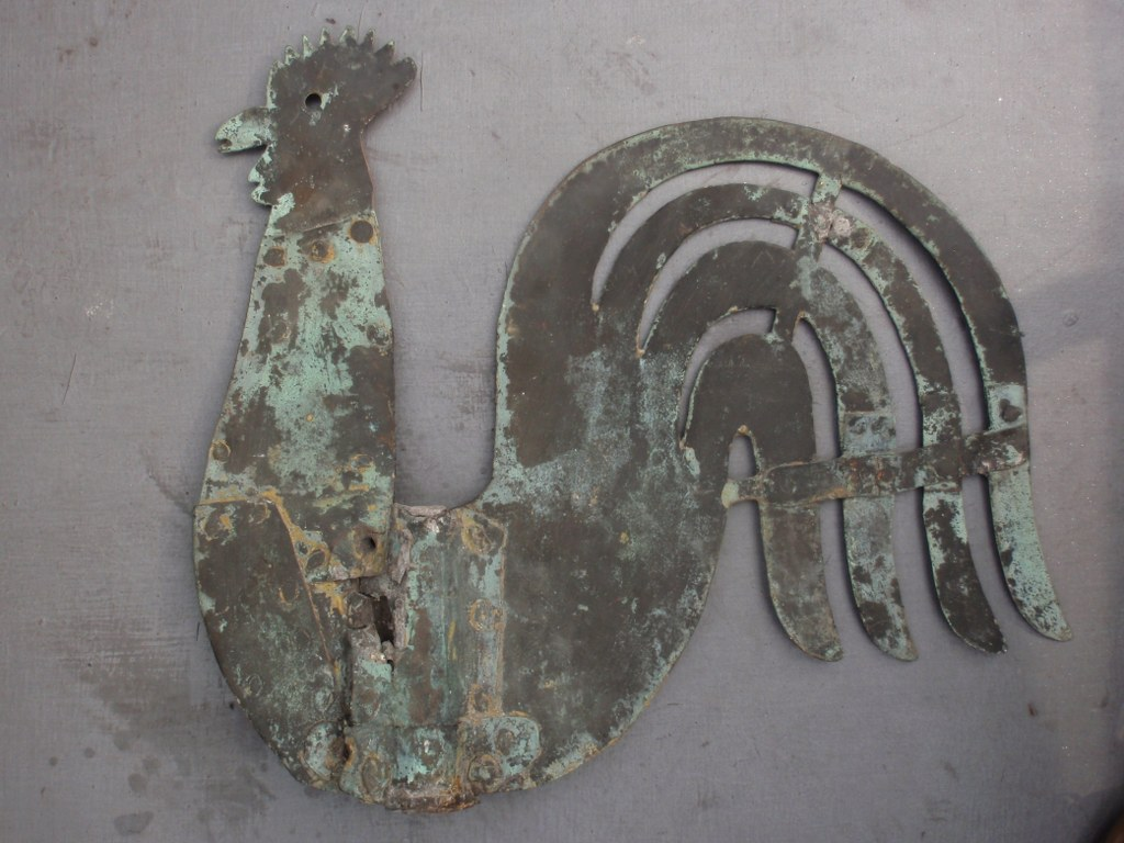 Antique weather vane in the shape of a cock