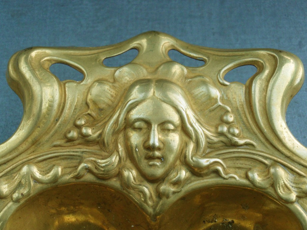 Gilded copper art nouveau dish with floral motifs and female heads 1900