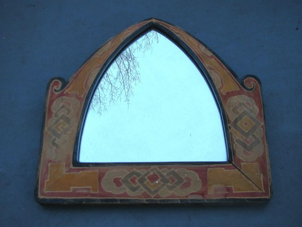 Amsterdam School mirror with batik frame