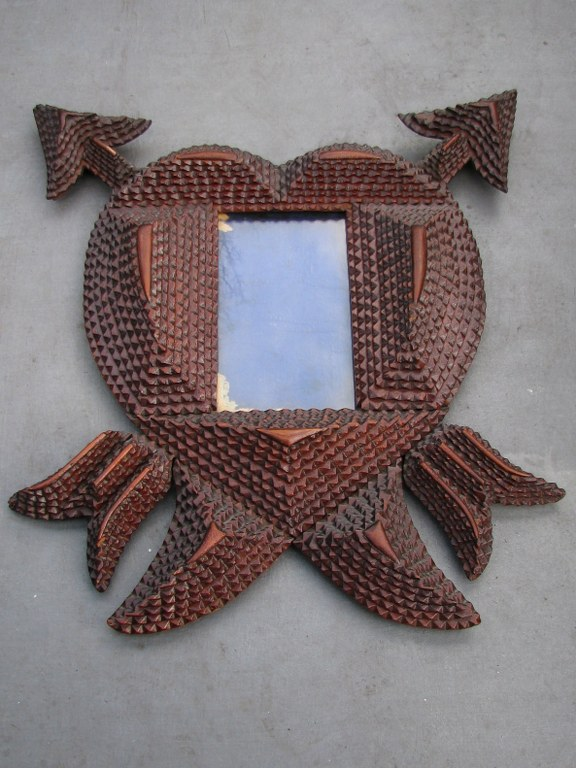 Handmade photo frame depicting heart with two arrows of Cupid