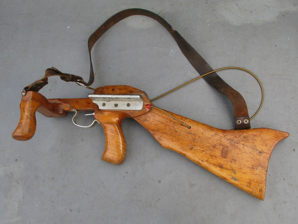 Vintage wooden rifle holder for camera with telelens